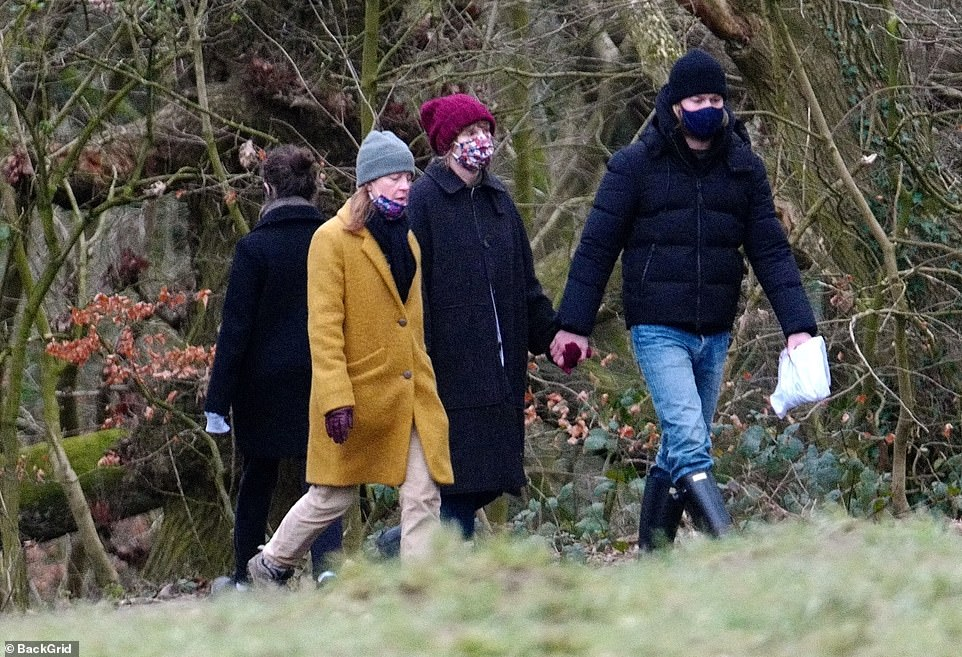 Loved: They grabbed their hand while hiking, and Elizabeth was walking along with Taylor