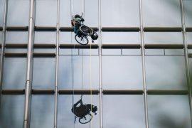 A paraplegic Hong Kong athlete in a wheelchair climbs a skyscraper